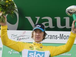 Bradley Wiggins of team Sky Procycling celebrates on the podium Sunday at the 66th Tour de Romandie UCI ProTour cycling race in Crans-Montana, Switzerland.