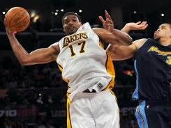Lakers center Andrew Bynum (17) grabs a rebound in front of Nuggets center JaVale McGee (34) in the first half of Game 1 on Sunday. Bynum finished with 10 points, 13 rebounds and 10 blocks.