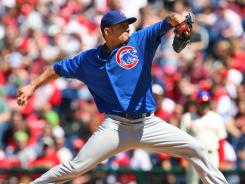 Cubs' Matt Garza gave up a pop-fly single to Jimmy Rollins leading off and retired 20 of the next 21 batters.
