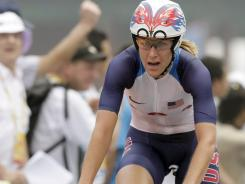 Kristin Armstrong of the United States reacts as she crosses the finish line to win the women's individual time trial at the Beijing Olympics on Aug. 13, 2008.