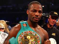 Chad Dawson poses with his belt after he won by 12-round decision against Bernard Hopkins during their WBC &amp; Ring Magazine Light Heavyweight Title fight at Boardwalk Hall Arena in Atlantic City on Saturday night.