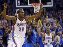 Oklahoma City Thunder forward Kevin Durant reacts after hitting the game-winning shot against the Dallas Mavericks in the fourth quarter of Game 1 in Oklahoma City on Saturday. The Thunder won won 99-98.