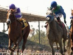 I'll Have Another, left, outruns Creative Cause to win the Grade I $750,000 Santa Anita Derby on April 7.