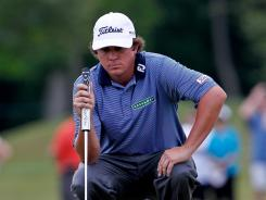 Jason Dufner lines up a putt on the ninth hole on his way to victory Sunday in the Zurich Classic of New Orleans, his first PGA Tour title.