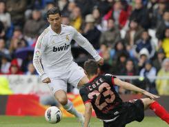 Cristiano Ronaldo's league-record 43rd goal helped Real Madrid beat Sevilla 3-0.