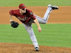Diamondbacks' Wade Miley flirts with a no-hitter until Marlins' John Buck doubles in the sixth inning.