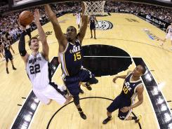 San Antonio big man Tiago Splitter, No. 22, sprained his left wrist in the Spurs' opening playoff victory Sunday vs. the Utah Jazz. His key minutes in the post will be missed if he's out for any length of time.