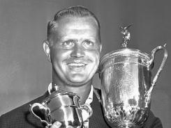 Jack Nicklaus holds his trophies after winning the 1962 U.S. Open Championship at the Oakmont, his first major title.