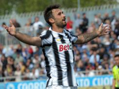 Mirko Vucinic celebrates one of his two goals that helped Juventus remain unbeaten in 35 league matches.