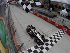 Will Power takes the checkered flag and the win during the IndyCar Series Sao Paulo 300 auto race on Sunday in Sao Paulo.