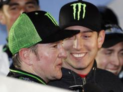 Kurt Busch, left, celebrates with brother and team owner Kyle Busch after winning the Virginia 529 College Savings 250 on Friday at Richmond International Raceway.