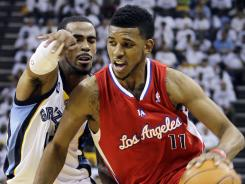The Los Angeles Clippers' Nick Young (11) moves the ball around Memphis Grizzlies' Mike Conley during the first half of the Clippers' Game 1 win over the Grizzlies on Sunday at Memphis.