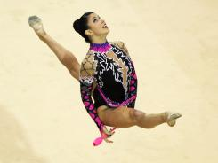 Julie Zetlin of the United States performs with the clubs at the Pan American Games in Guadalajara, Mexico, on Oct. 18, 2011.