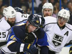 Los Angeles' Dustin Penner and Anze Kopitar mix it up with St. Louis' David Backes.