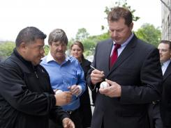 Roger Clemens signs a baseball for a fan Monday after leaving court in Washington, where he is on trial for allegedly lying to Congress.