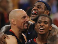 Jason Kidd, LeBron James and Chris Paul celebrate their victory over Spain in the final seconds of the gold medal game at the Beijing Olympics on Aug. 23, 2008.