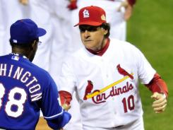 Tony LaRussa, right, shaking hands with Rangers manager Ron Washington during last year's World Series, holds the Cardinals record with 1,408 managing wins and produced eight division titles, three NL pennants and World Series championships in 2006 and 2011.