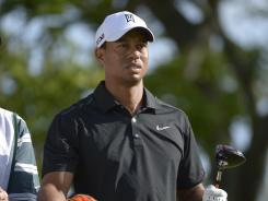 Tiger Woods waits to make his tee shot on the 15th hole during the first round of the Arnold Palmer Invitational golf tournament at Bay Hill in Orlando, Fla.