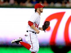 Bryce Harper runs off the field in the seventh inning in his home debut with the Nationals.