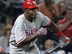 The Phillies' John Mayberry Jr. doubles during what proved to be the decisive eighth inning vs. the Braves on Tuesday night.