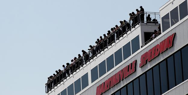 Spotters hover over Martinsville Speedway earlier this year. NASCAR requires in-race radio communication to be done over analog (public) air waves, which allows fans, news media and fellow competitors to listen in.