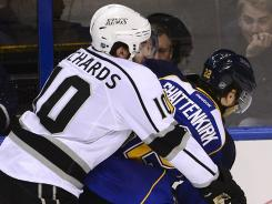 Los Angeles Kings center Mike Richards (10) checks St. Louis Blues defenseman Kevin Shattenkirk during Game 1.