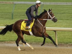 Retired Jockey Larry Melancon rides Kentucky Derby hopeful Mark Valeski during a morning workout at Churchill Downs in Louisville, Ky., on Monday. Valeski will not be competing in the race on Saturday.