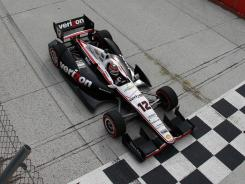 Will Power takes the checkered flag at Sunday's Sao Paulo 300 for his third IndyCar win in 2012.