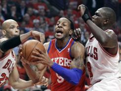 Philadelphia forward Andre Iguodala (9) drives to the basket between Chicago forwards Taj Gibson (22) and Luol Deng (9) during the first quarter of the 76ers win over the Bulls in Game 2 of their playoff series on Tuesday night.