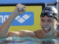 In this Aug. 10, 2010 file photo, Norway's Alexander Dale Oen celebrates winning the gold medal in the men's 100 breaststroke final at the Swimming European Championships in Budapest, Hungary. He collapsed Monday and swimming federation officials said the cause of death was cardiac arrest.