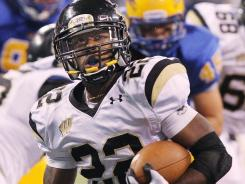 Running back Deionte Buckley is one of three players from Warren Central High in Indianapolis who graduated early to enroll at Cincinnati.