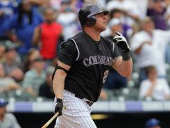 Rockies pinch hitter Jason Giambi watches his game-winning home run against the Dodgers on Wednesday. The three-run homer brought the total number of runs scored in the final two innings to 10.