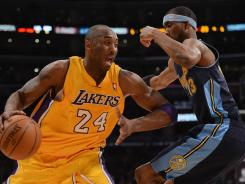Los Angeles' Kobe Bryant drives on Denver's Corey Brewer during Game 2 of the Western Conference quarterfinals on Tuesday at Los Angeles. The Lakers beat the Nuggets 104-100 to take a 2-0 series lead.