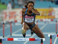 Lashinda Demus wins the women's 400-meter hurdle semifinal in 53.82 seconds during the 2011 IAAF World Championships in Daegu, South Korea.