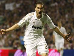Real Madrid's Argentinian forward Gonzalo Higuain celebrates after scoring a goal during the Spanish league final against Athletic Bilbao on Wednesday. Madrid won 3-0 to take the championship.