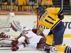Nashville Predators center David Legwand scores a goal against Phoenix Coyotes goalie Mike Smith in Game 3.