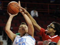 Sydney Moss, shown driving to the basket, swept Kentucky basketball awards as a senior at Boone County (Florence, Ky.). She is the daughter of NFL player Randy Moss.