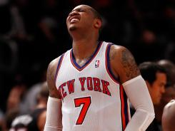 New York Knicks forward Carmelo Anthony had to be a one-man band without injured Amar'e Stoudemire available, and the Miami Heat took advantage for an 87-70 win Thursday and a 3-0 playoff series lead. Game 4 is Sunday at Madison Square Garden.