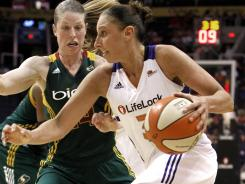 Diana Taurasi (right) of the Phoenix Mercury drives past the Seattle Storm's Katie Smith during a WNBA game Aug. 16, 2011, in Phoenix.