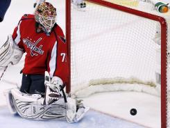 Washington Capitals goalie Braden Holtby looks back at the puck after New York Rangers right wing Marian Gaborik scored in the third overtime.