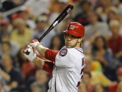 Bryce Harper belts an RBI double during the sixth inning to give the Nationals a 2-1 lead against the Diamondbacks.