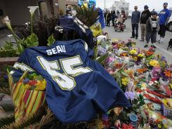 Junior Seau's No. 55 Chargers jersey is part of a memorial set up Thursday in the driveway of his Oceanside, Calif., after his death stunned Southern California.