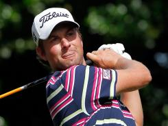Webb Simpson hits his tee shot on the 12th hole during the first round of the Wells Fargo Championship.