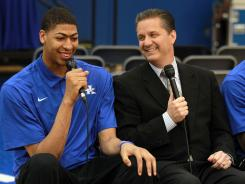 Kentucky's Anthony Davis, left, sitting next to coach John Calipari, is expected to be the first pick in the June 28 NBA draft.