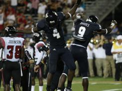 Florida International Golden Panthers running back Kedrick Rhodes (9) celebrates his touchdown with wide receiver T.Y. Hilton (4) in a game last season.