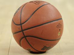 An Arkansas high school coach won't allow a youngster to dribble a basketball for the team, a move that has the student's mother in a legal lather.