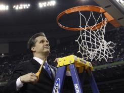 Kentucky head coach John Calipari cuts down the net after the national championship game.