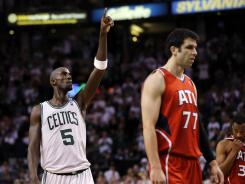 Boston Celtics center Kevin Garnett celebrates Friday's overtime victory vs. the Atlanta Hawks for a 2-1 lead in their Eastern Conference playoff series.