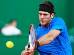 Juan Martin del Potro lines up a backhand during his victory Friday against Albert Montanes of Spain in the Estoril Open.