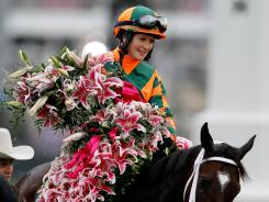 Rosie Napravnik sits atop Believe You Can with the Lilly's after winning the 138th running of the Kentucky Oaks at Churchill Downs on Friday.